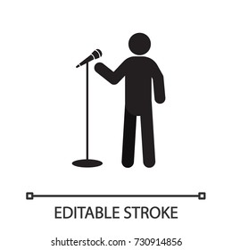 Man with microphone silhouette icon. Singer. Person making speech. Isolated vector illustration. Editable stroke