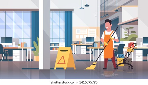 man mopping floor male cleaner janitor in uniform cleaning service concept trolley cart with supplies creative co-working center office interior flat full length horizontal