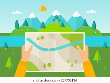 Man on a hiking trip holding a map in his hands. Nature landscape of mountains, hills, meadows and river.