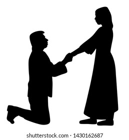 Man on knees holding hands of woman and asking her to marry