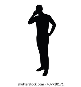 Man on the phone while standing. Vector silhouette of a man with a mobile phone