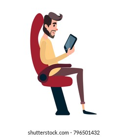 A man is a passenger on a bus or plane. A young man sits in the airplane's chair and looks at the tablet. The bus seat is occupied by the reading man.