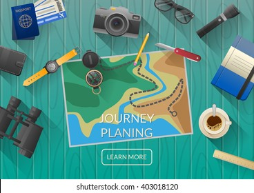 Man planning vacation trip with map. Top view. Outfit of modern traveler. Objects on wooden background.