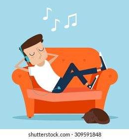 Man resting at home. Laying on sofa and listening music