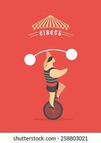 man rides a bicycle circus shows his strength holding the post