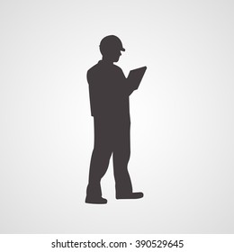 Man silhouette standing sideway in helmet and with clipboard in his hands vector icon