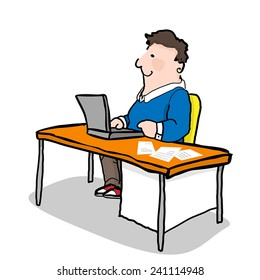 Man sitting at the desk and working on the laptop