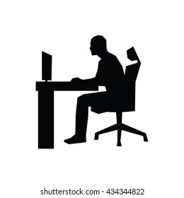 Man sitting on office chair at table and working on computer. Side view. Vector silhouette. Businessman works in office at desk and staring into monitor