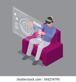 Man sitting on sofa at home wearing Virtual Reality Headset. Technology, cyberspace and people concept