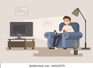 Man sitting on sofa watching tv and drink cup of coffee