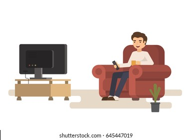 Man sitting on sofa watching tv and drink cup of coffee.