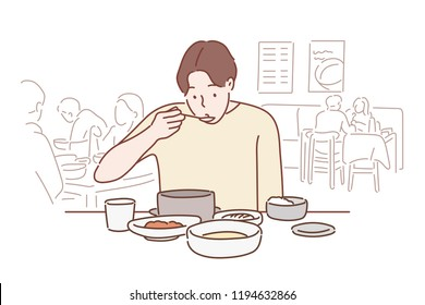 A man is sitting at a restaurant and is having a Korean meal. hand drawn style vector design illustrations.