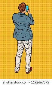 Man with smartphone back. Pop art retro vector illustration vintage kitsch