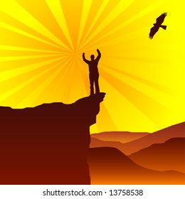 Man standing on top of cliff greeting the sun with eagle flying overhead