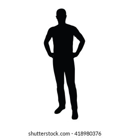 Man standing in shirt and jeans with hands on hips. Vector silhouette of man standing. Front view