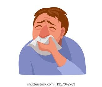 man tormented by a runny nose. man wipes his nose with a handkerchief