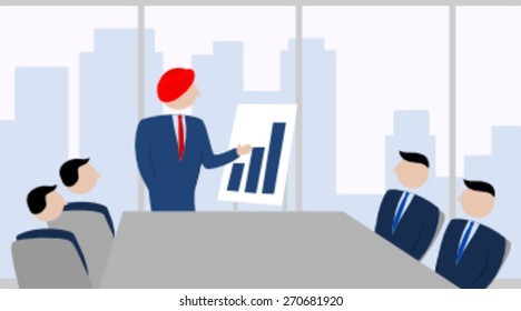 Man with a turban presenting in an office