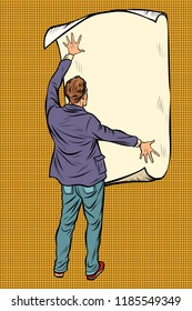 man unfolded poster paper, announcement on the wall. Pop art retro vector illustration vintage kitsch