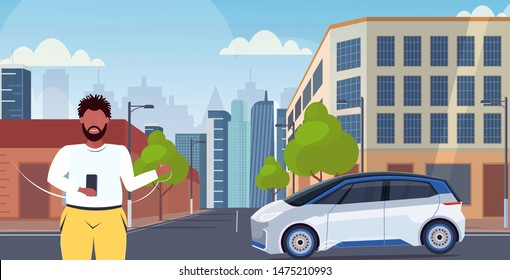man using smartphone mobile app online ordering taxi car sharing concept transportation carsharing service modern city street cityscape background horizontal portrait