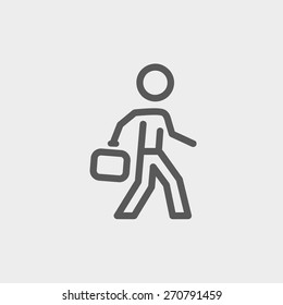 Man walking with briefcase icon thin line for web and mobile, modern minimalistic flat design. Vector dark grey icon on light grey background.