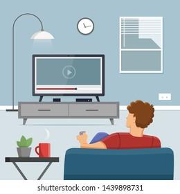 Man watching TV in living room