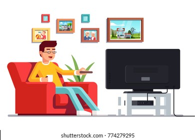 Man wearing glasses sitting on armchair watching tv switching channels with remote holding mug in right hand. Living room with tv and framed family pictures on wall. Flat vector isolated illustration.