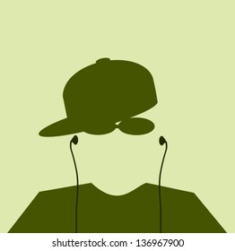 man wearing hat sideways and earphones with sunglasses