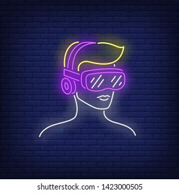 Man wearing virtual reality headset neon sign. Technology, innovation, gaming design. Night bright neon sign, colorful billboard, light banner. Vector illustration in neon style.