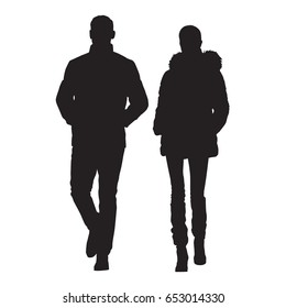 Man and wife are dressed in winter clothes. Walking people, young couple. Vector silhouettes