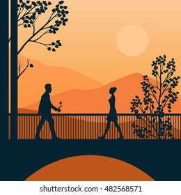The man and the woman are going to meet each other. Rendezvous on the bridge. Sunset in the mountains