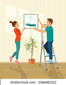 Man and woman hanging picture on the wall.  Vector flat style illustration