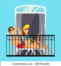 Man and woman married couple sunbathe on the balcony relaxing at home in the sun in bathing suits. Enjoying summer season from balcony of apartment or hotel room. Fun sunbathe activity indoor