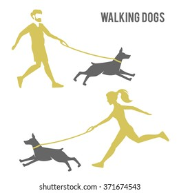 A man and a woman walking a dog.