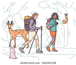 A man and a woman are walking on a forest path with backpacks. Forest animals are watching them. hand drawn style vector design illustrations.