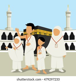 Man and Wowan with Their Children Wearing Ihram Clothes Performing Hajj or Umrah Pilgrimage with Kaaba in Makkah Background