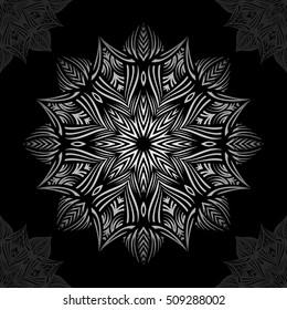 Mandala. Silver round ornament pattern on black background.