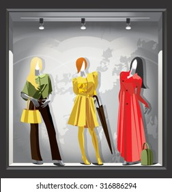 Mannequins in bright demi-season clothes in a shop window