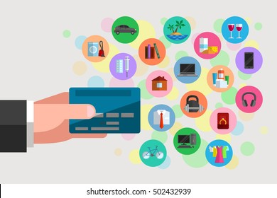 Man's hand is holding a plastic bank card. Icons of various goods and services nearby. Possible purchases and spendings available by using bank debit or credit card