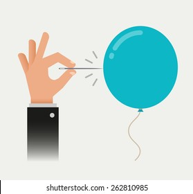 Man's hand with a needle pierces the balloon