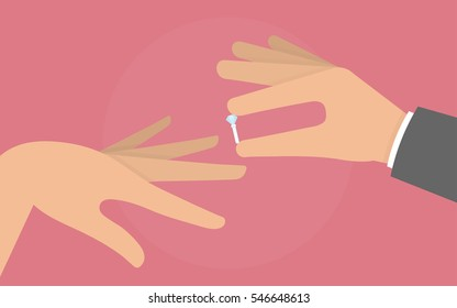 Mans hand putting a diamond ring on a womans finger. Engagement concept