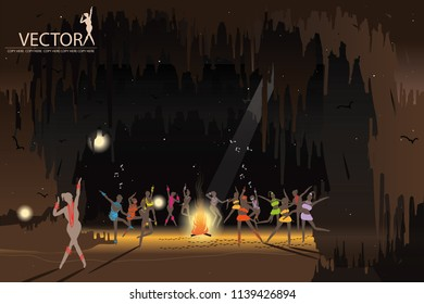 many people dancing around campfire on cave background