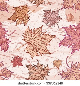 Maple leaves on a grunge background. Vector seamless pattern.