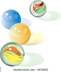 marbles ( two cat's eye) like those used for children's games.