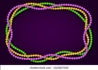 Mardi gras traditional necklaces on a dark purple background.