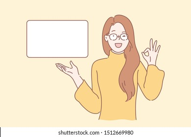 Marketing, advertising, promotion, approval concept. Young woman or girl businessman makes a okay gesture, a symbol of approval. lady or teenager blinks eye and like, indicating the free space.