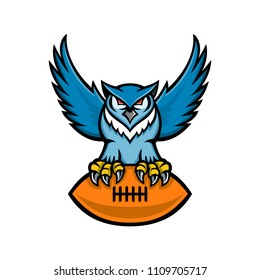 Mascot icon illustration of a great horned owl, tiger owl or hoot owl, a large owl native to the Americas, clutching an American football ball viewed from front on isolated background in retro style.
