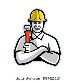 Mascot icon illustration of a pipefitter, a tradesperson who install, fabricate, maintain and repair mechanical piping systems, holding a pipe wrench  viewed from front in retro style.