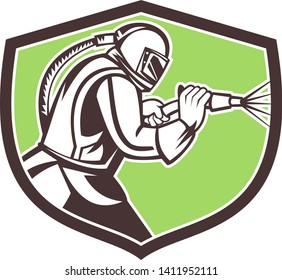 Mascot icon illustration of a sandblaster or sand blaster abrasive blasting viewed from side set inside crest or shield on isolated background in retro style.