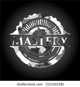 Mastery written on a grey camouflage texture
