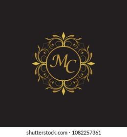 MC Initial logo. Ornament ampersand monogram golden logo black background